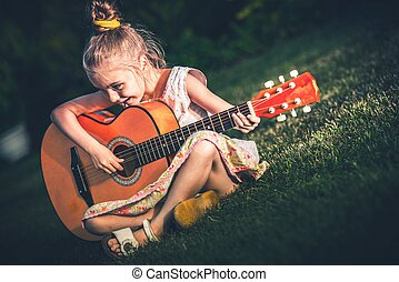 Little Girl Playing Guitar - Little Girl Playing Acoustic...