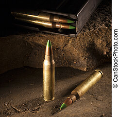 Armor piercing ammo - Cartridges with a green tip and a...