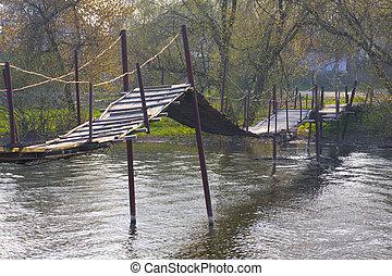 footbridge over small riwer in ukraine