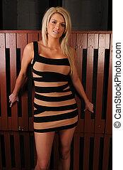Blonde - Beautiful statuesque blonde in a short dress in...
