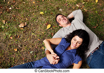 Daydream Park Couple - A happy couple daydreaming in a park...