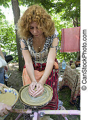 woman learning the pottery
