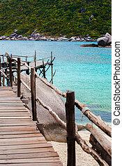 Blue Transparent Sea with wooden bridges