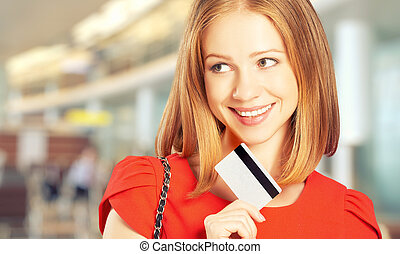 happy woman with a credit card went on shopping