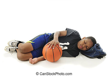 Tuckered Out Basketball Tween - A preteen athlete asleep...