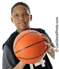 Preteen Basketball Shooting Close-up - Close-up image of a...