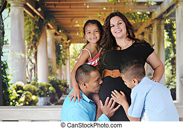 Pregnancy, a Family Affair - A happy mom-to-be-again and her...