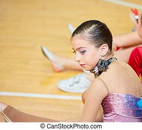 kid girl rhythmic gymnastics on wooden deck profile