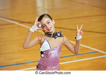 kid girl rhythmic gymnastics on wooden deck medal winner...