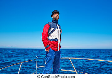 Beard sailor cap man sailing sea ocean in a boat