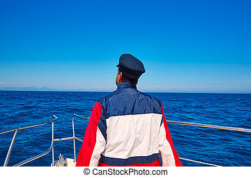 rear sailor cap man sailing sea ocean in a boat