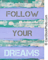 FOLLOW YOUR DREAMS motivational quote - Concept image of...