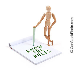 Wooden mannequin writing in scrapbook - Know the rules