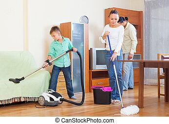 Ordinary family doing housework - Ordinary family of three...