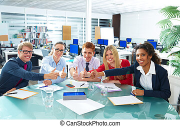 Multi ethnic business meeting thumbs up gesture happy...