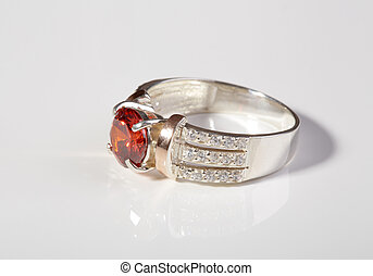 Jewelry. - Beautiful gold ring with gemstones on white...