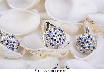 Jewelry. - Beautiful gold ring and earrings with blue...