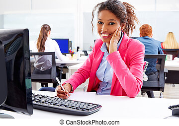 african young businesswoman working in office with computer