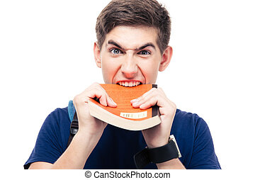 Angry male student biting book isolated on a white...