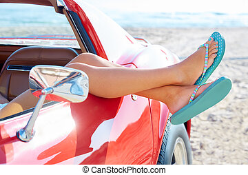 Relaxed woman legs in a car window on the beach - Relaxed...