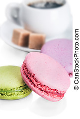 Cup of coffee and macaroons on white background focus...