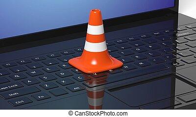Orange traffic cone on black laptop keyboard