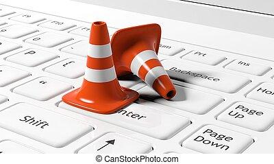 Orange traffic cones on white laptop keyboard