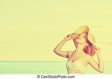 beauty happy woman in hat enjoy sea at sunset on beach