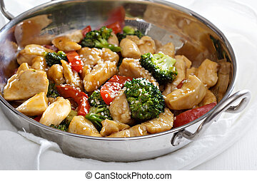 Chicken and vegetables stir fry - Chicken, broccoli and red...