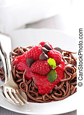 Cooked chocolate pasta with raspberry sauce