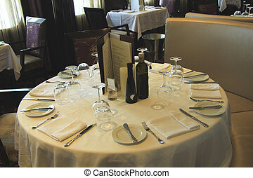 Table setting - Luxurious restaurant interior with set...
