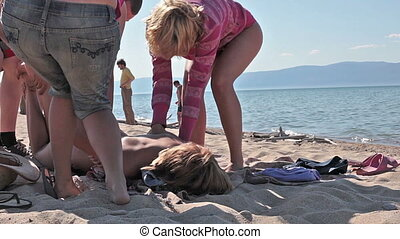 Teenagers fooling around at the beach