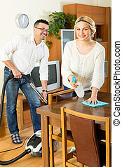 Family couple cleaning at home - Cheerful young couple...