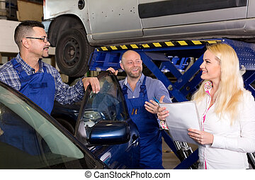 Two workers and manager - Two smiling troubleshooters...