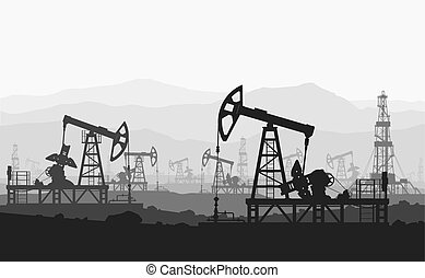 Oil pumps at large oilfield over mountain range. Detail...