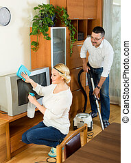 Family couple cleaning at home together and smiling Focus on...