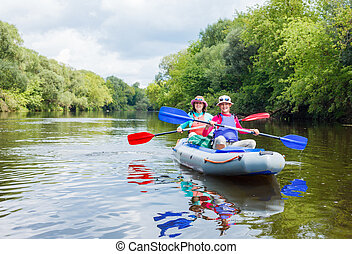 Girl with her mother kayaking - Summer vacation - Happy girl...