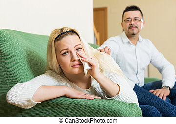 Couple after quarrel - Man asking for forgiveness from...