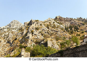 fortress ruins - the fortress ruins located on the mountain...