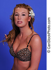 Blonde - Statuesque blonde woman in a leopard print...