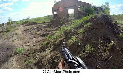 shoot from airsoft automatic rifle - Person shoot from...