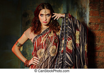 Indian woman - Young beautiful woman in bright Indian...