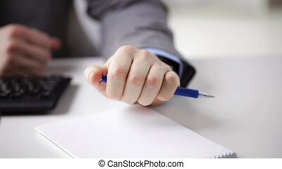 close up of businessman hands with notepad - people,...
