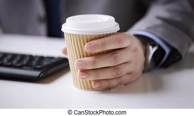 close up of businessman hand with coffee paper cup - people,...