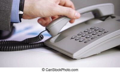 close up of businessman hand dialing phone number - people,...