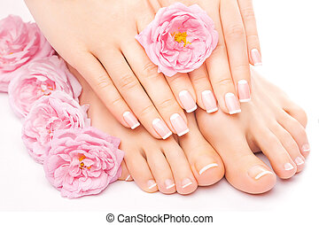 pedicure and manicure with a pink rose flower - french...