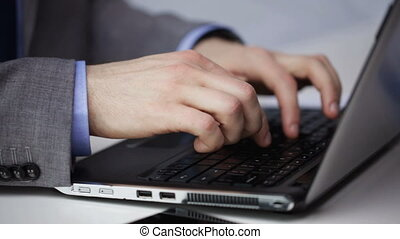 close up of businessman hands typing on laptop - people,...