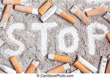 Quit smoking background - Cigarette butts and ashes. Quit...
