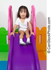 Children Sliding - Asian Chiense girl sliding at indoor...