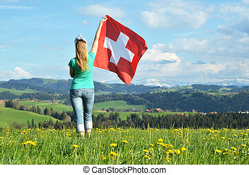 Girl holding Swiss flag Emmental, Switzerland